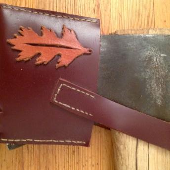 Handmade leather axe sheath with oak leaf detail