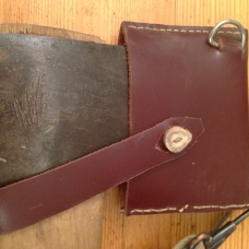 Reverse view of handmade axe sheath with antler button and leather latch