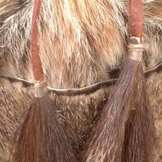 Detail of woodchuck tail tassels