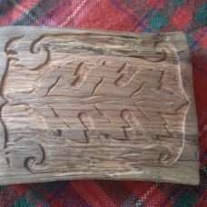 Hand carved belt buckle from red oak.